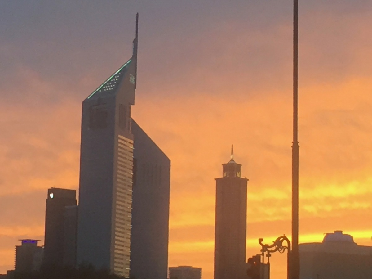 Sunset over Emirates Towers Dubai UAE